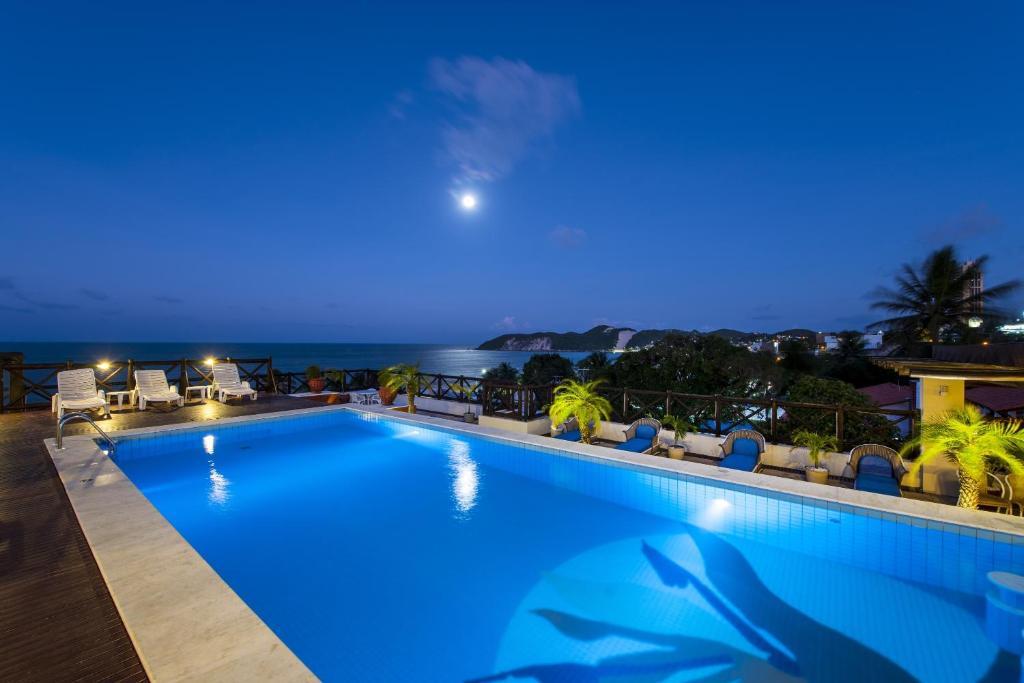 The swimming pool at or near Pérola Praia Hotel
