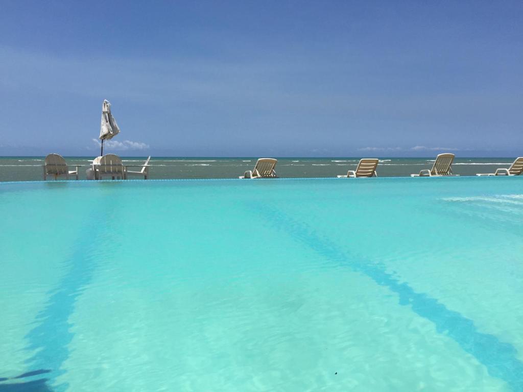 The swimming pool at or near Arraial Praia Hotel Pousada
