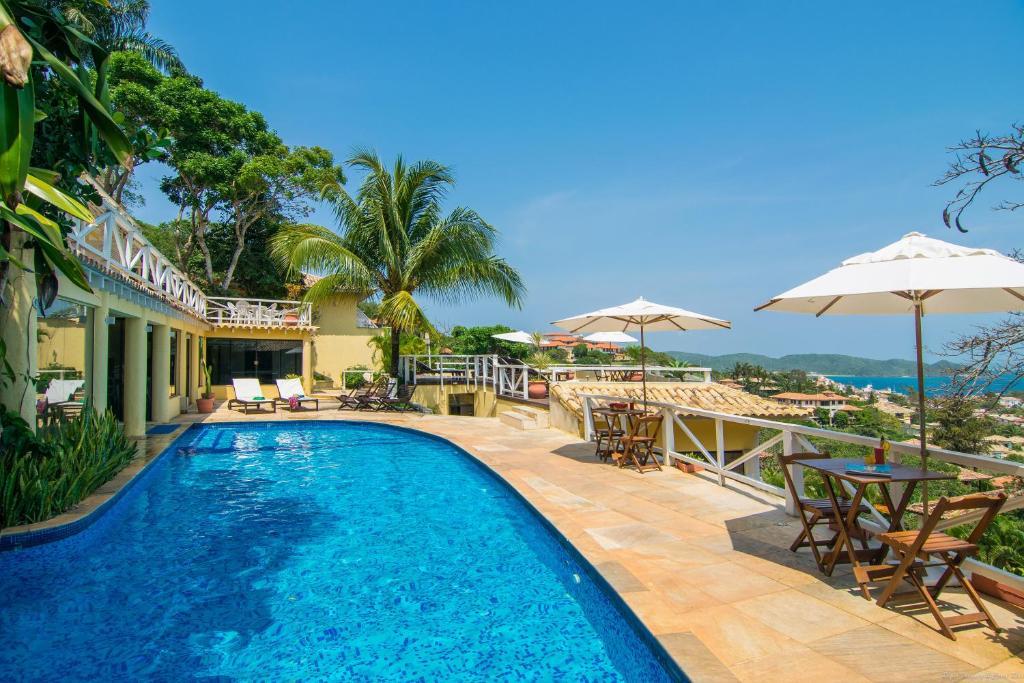 A piscina localizada em Pousada e Spa Villa Mercedes ou nos arredores