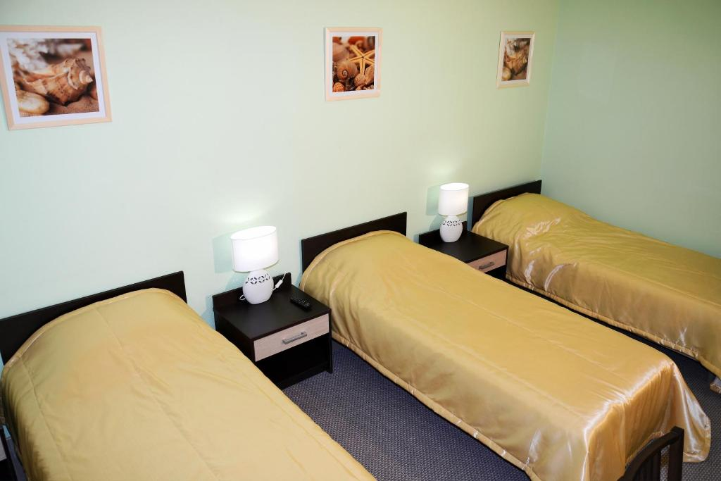 A bed or beds in a room at Rainbow MiniHotel