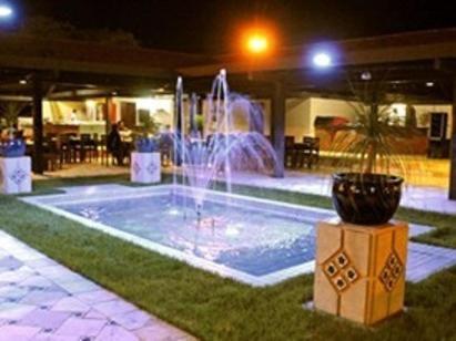A piscina localizada em Pousada Fazenda Santa Fe ou nos arredores