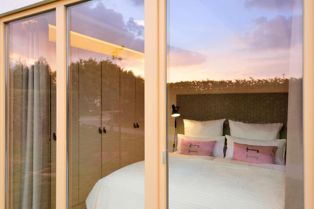 Ein Bett oder Betten in einem Zimmer der Unterkunft Hainichhöfe Premiumchalets