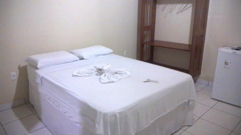 A bed or beds in a room at Hotel Mandari