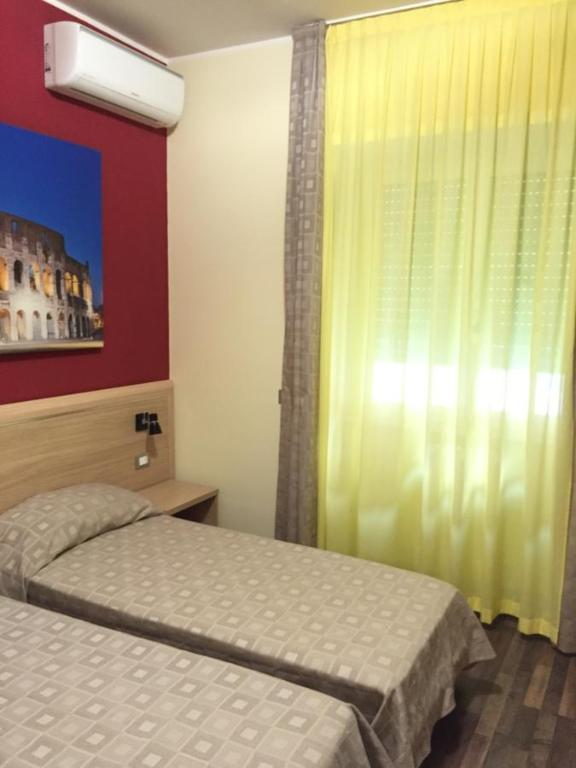 A bed or beds in a room at Sogno Di Roma