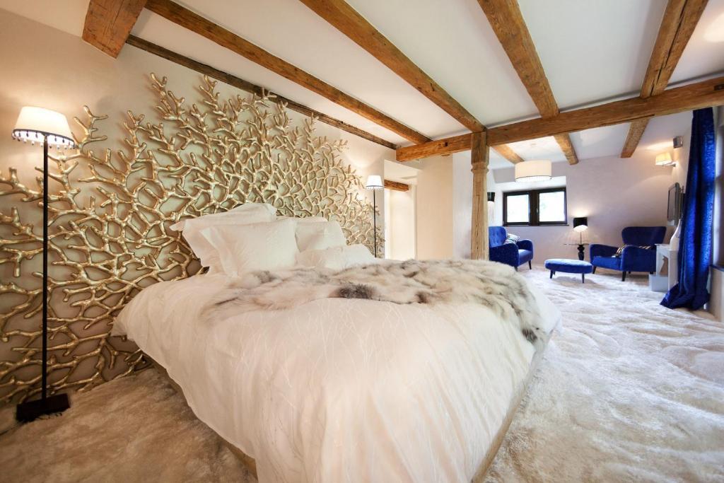 Un ou plusieurs lits dans un hébergement de l'établissement Maison d'hôtes de coeur et d'exception - Du coté de chez Anne