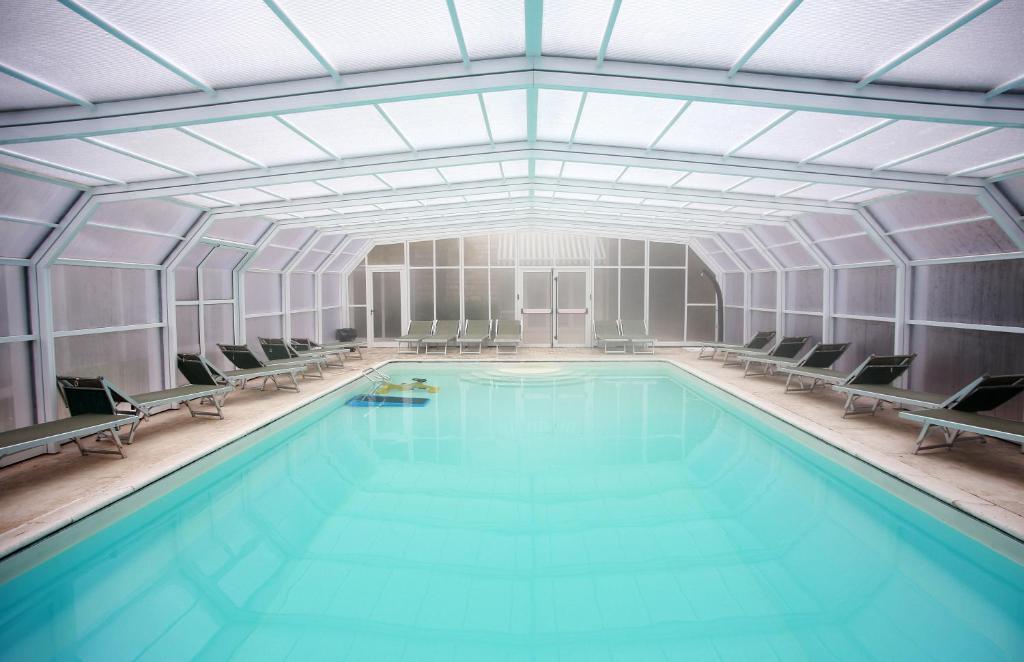 The swimming pool at or near Adua & Regina di Saba Wellness & Beauty