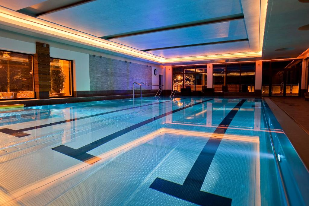 The swimming pool at or near Malinowy Dwór Hotel Medical SPA