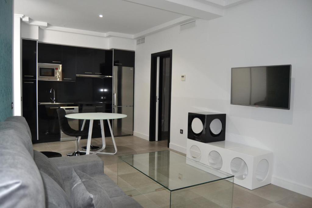 Телевизор и/или развлекательный центр в Apartamentos Las Palmeras
