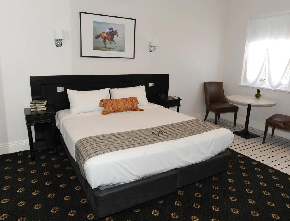 A bed or beds in a room at The Yarrawonga Hotel