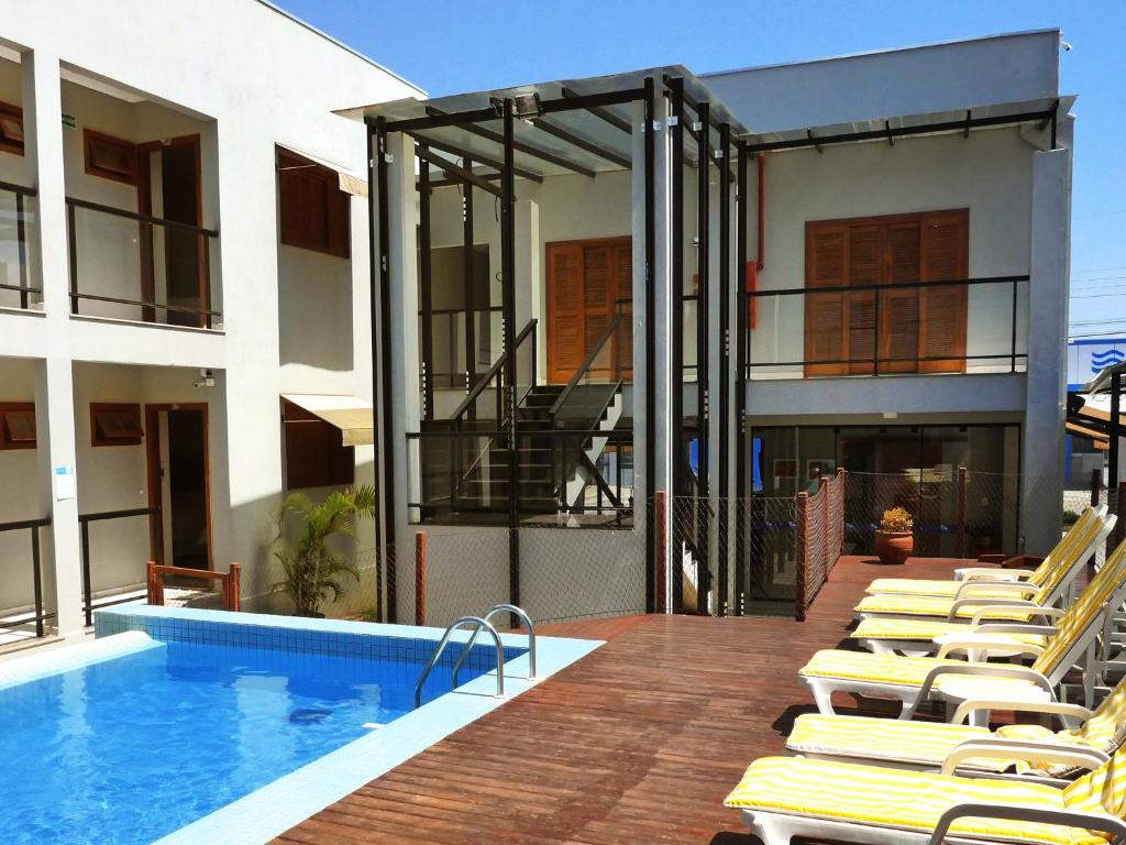 The swimming pool at or near CLH Suites Bonito Centro