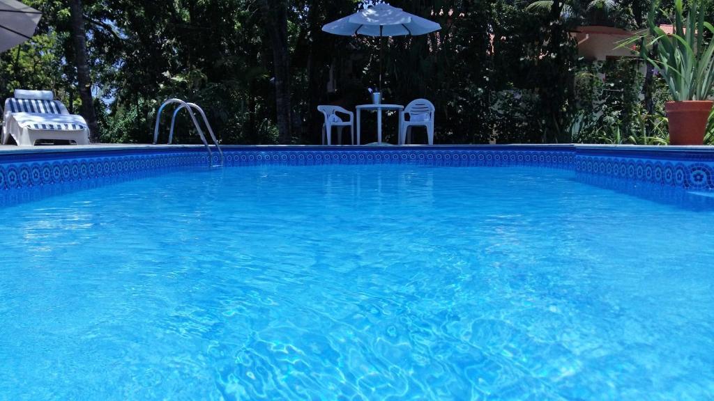The swimming pool at or near Pousada Recanto da Terra