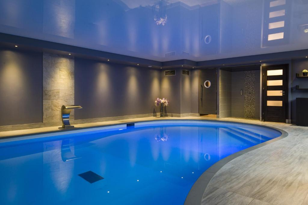The swimming pool at or near Espace Zen'ing