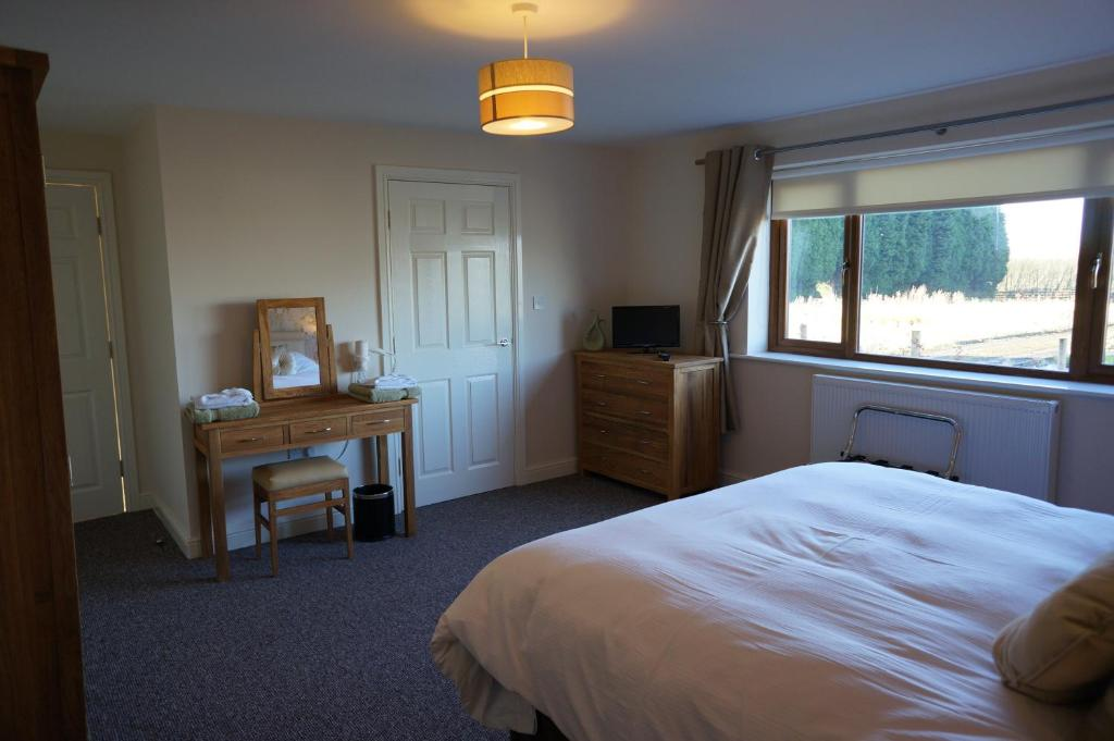 A bed or beds in a room at Forest View Holiday Park