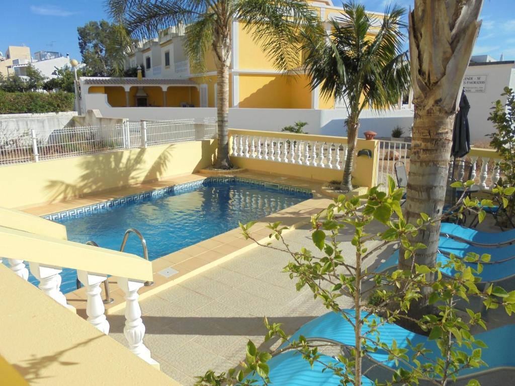 A view of the pool at Apartamentos AquaRia Fuseta or nearby