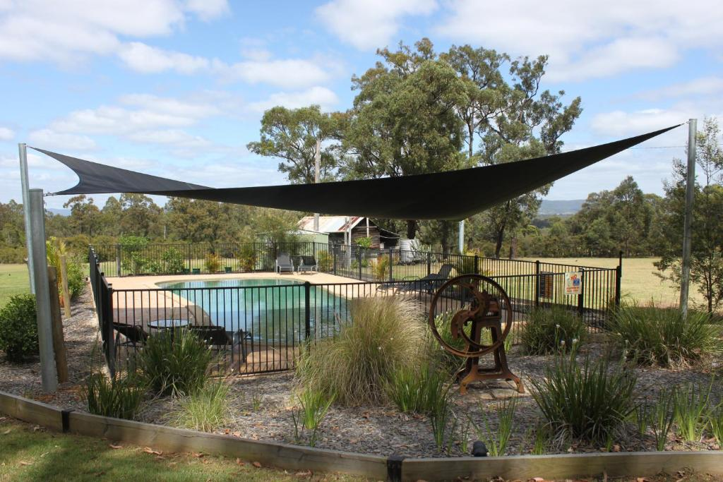 The swimming pool at or near Woodlane Cottages Hunter Valley