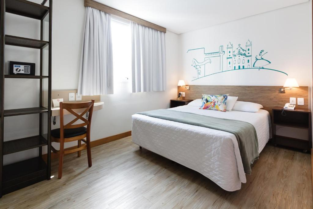 A bed or beds in a room at Garibaldi Business Hotel