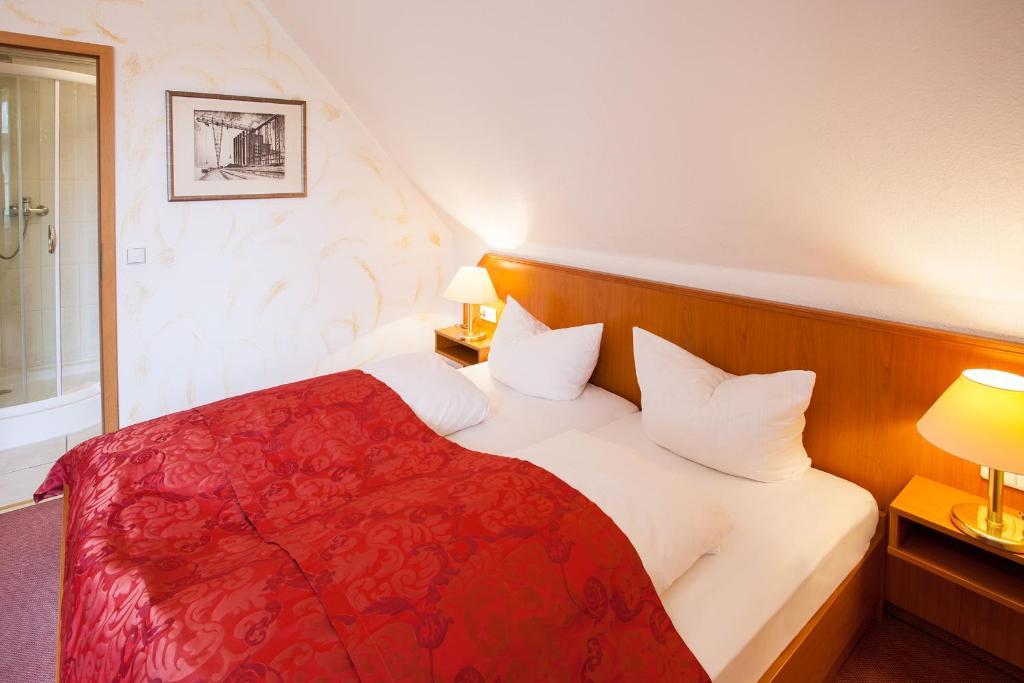 Кровать или кровати в номере Hotel Alter Wolf