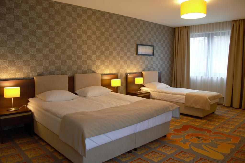 Łóżko lub łóżka w pokoju w obiekcie Hotel Via Baltica