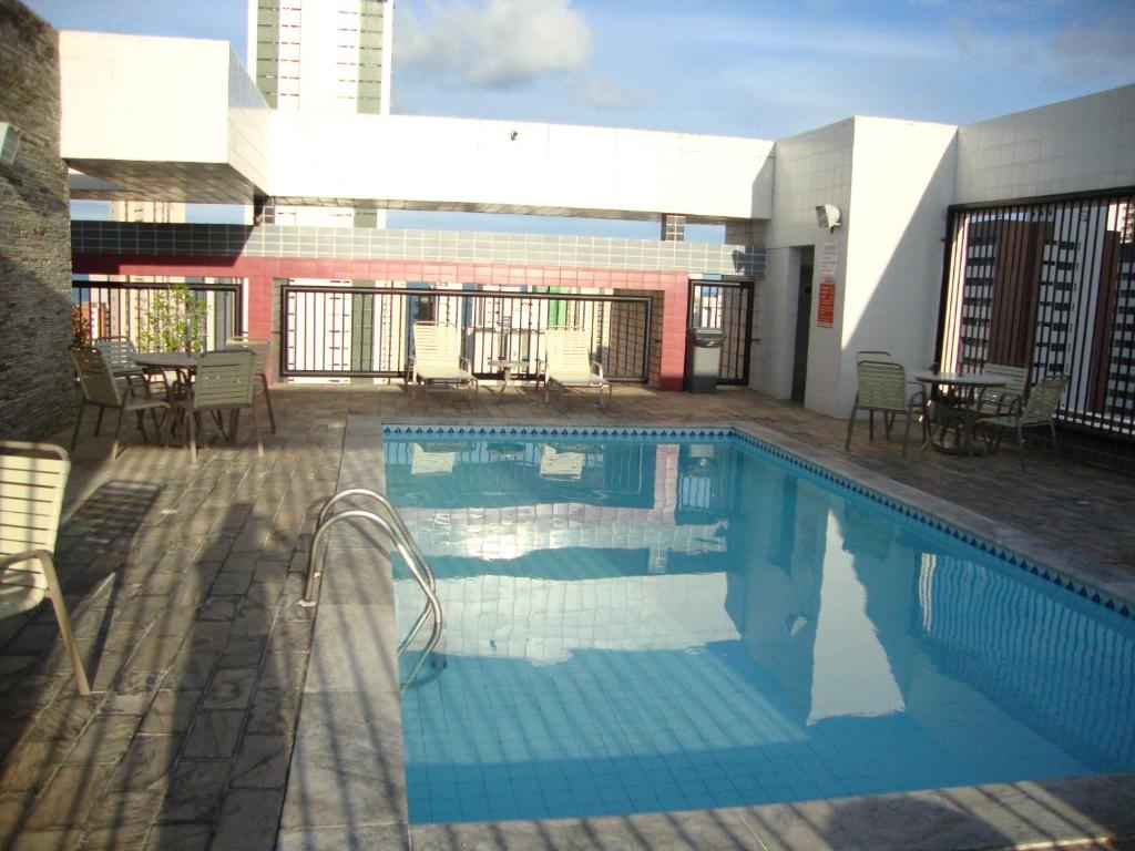 The swimming pool at or close to Flat Ametista Home Service
