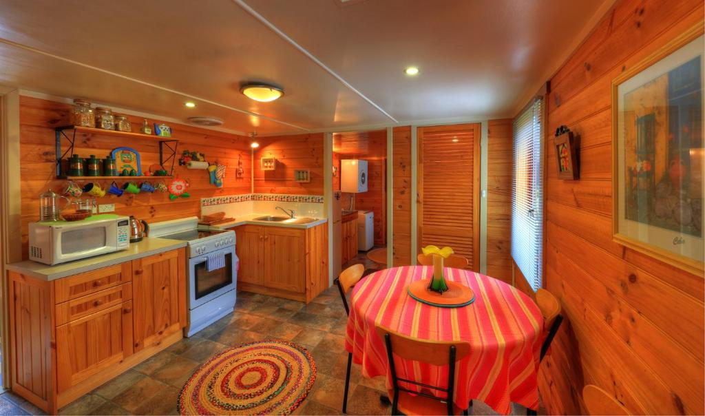 A kitchen or kitchenette at Rosebank Cottage Collection