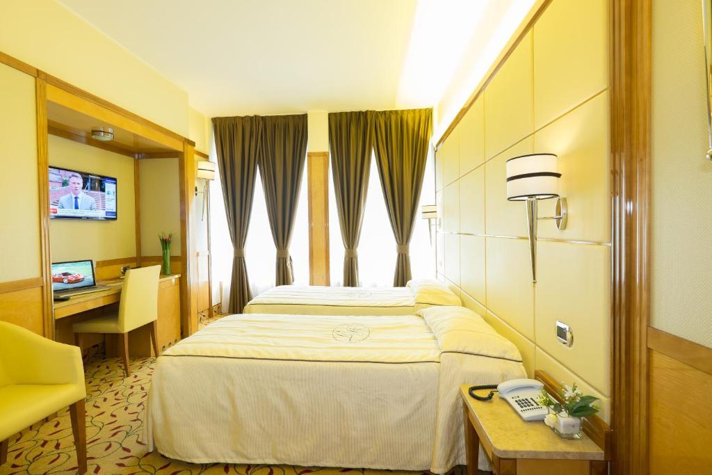 Ein Bett oder Betten in einem Zimmer der Unterkunft Hotel Teco