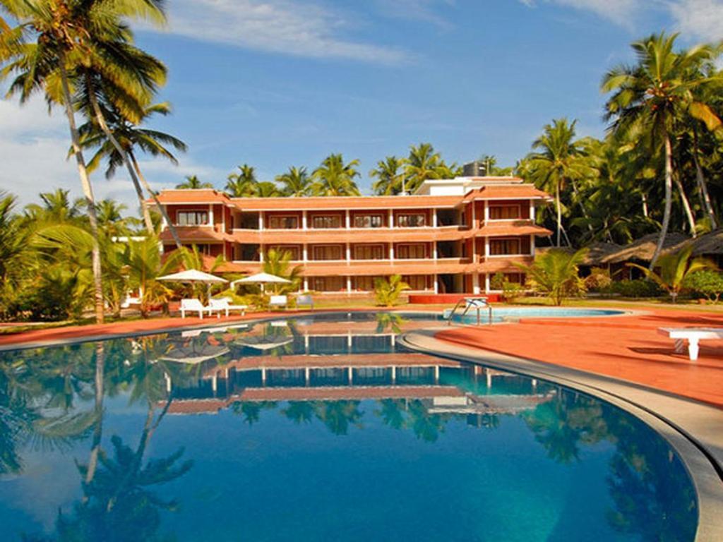 The swimming pool at or near Abad Harmonia Ayurvedic Beach Resort