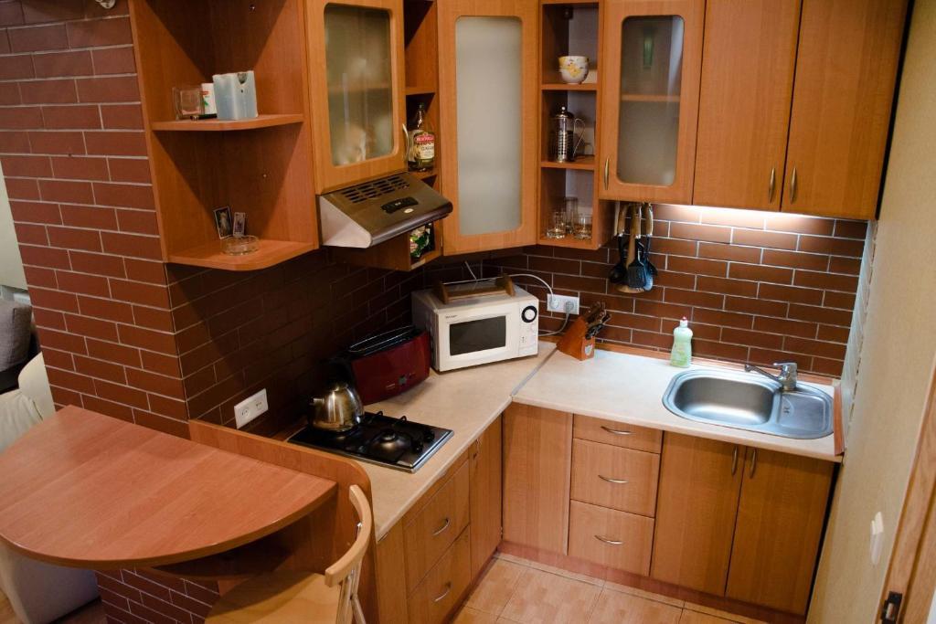 A kitchen or kitchenette at InLviv Apartments