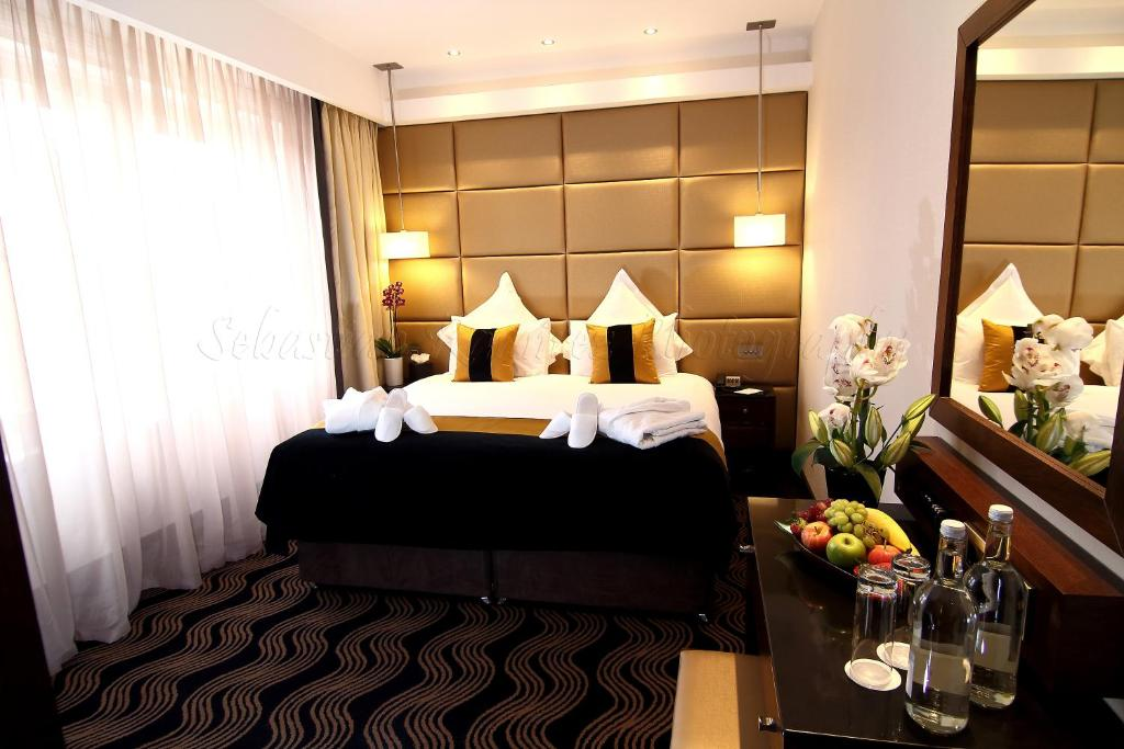 A bed or beds in a room at The Piccadilly London West End