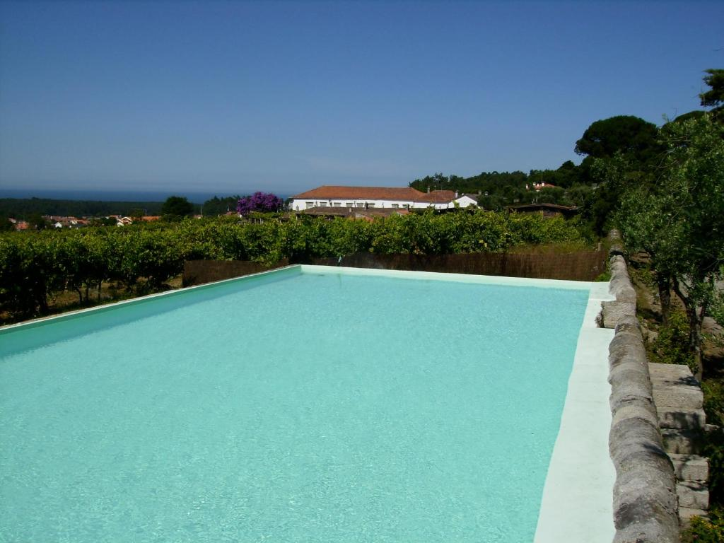 The swimming pool at or near Quinta do Paco d'Anha