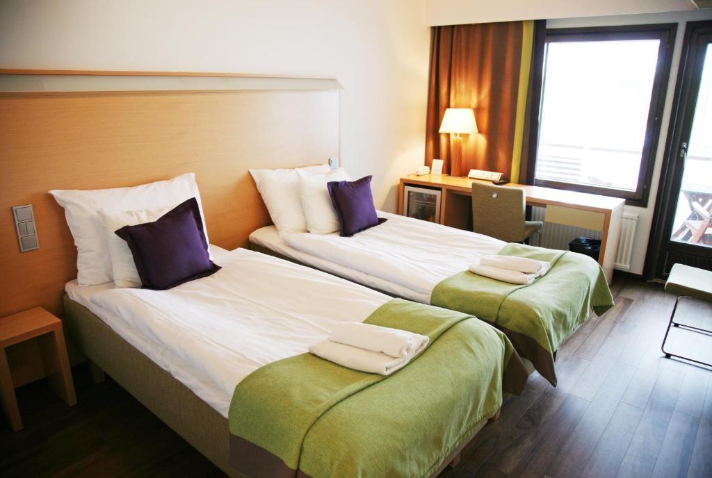 Vuode tai vuoteita majoituspaikassa Hotel Anttolanhovi