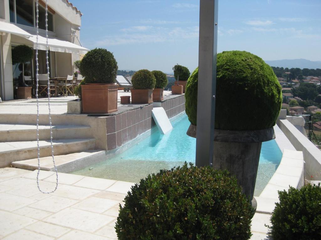 The swimming pool at or close to La Villa Blanche