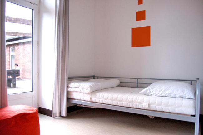 Ein Bett oder Betten in einem Zimmer der Unterkunft Hostel Flensburg