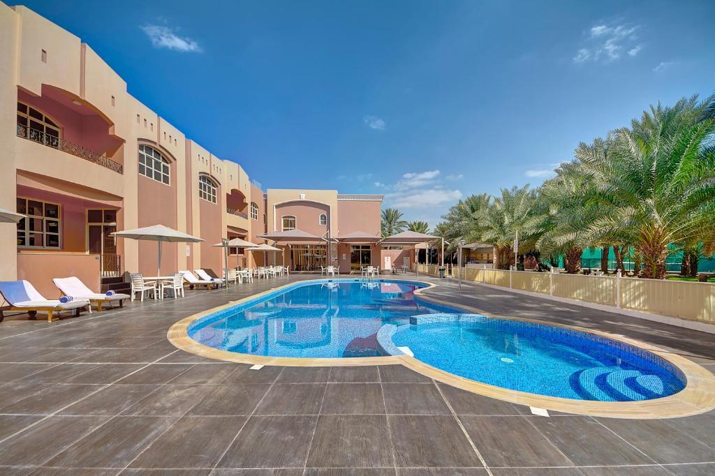 The swimming pool at or near Asfar Resorts Al Ain