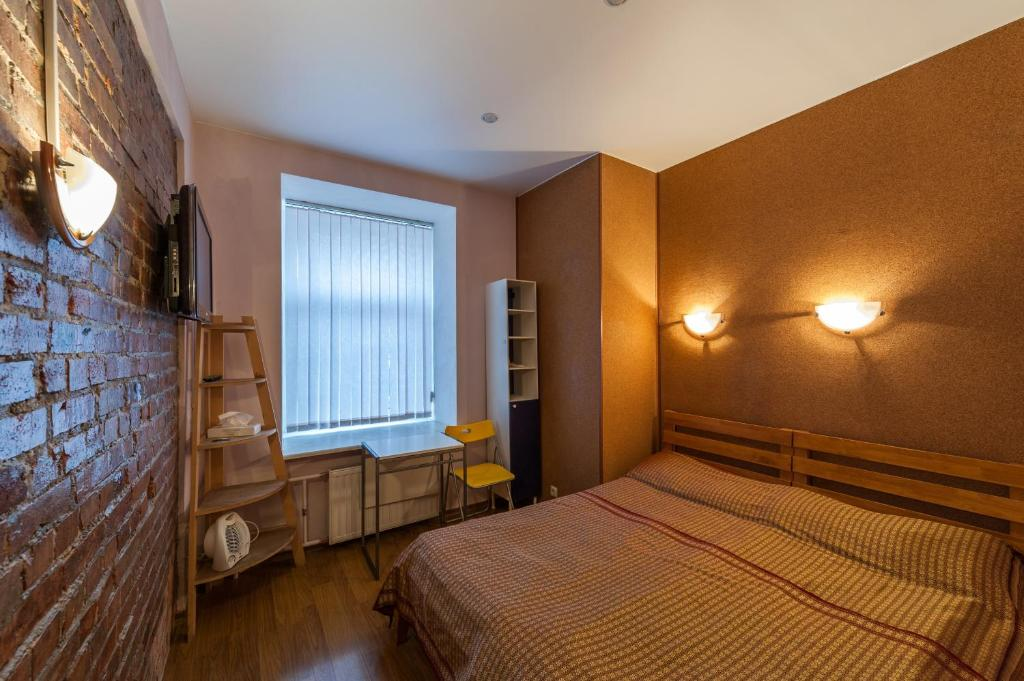 Ein Bett oder Betten in einem Zimmer der Unterkunft Canny House