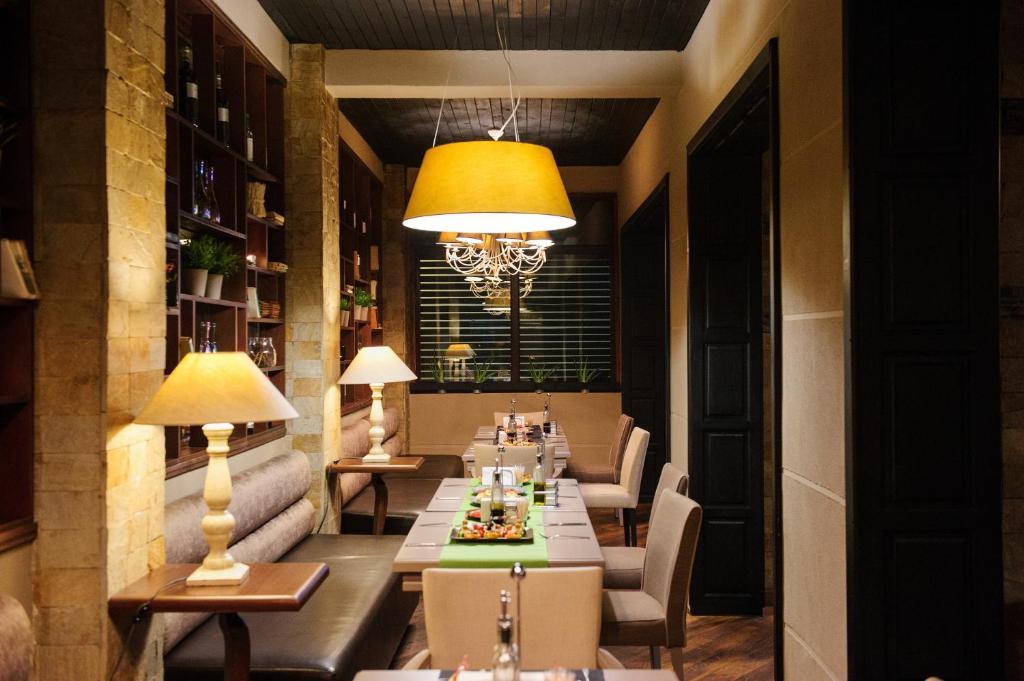 Ресторант или друго място за хранене в Hotel Papi