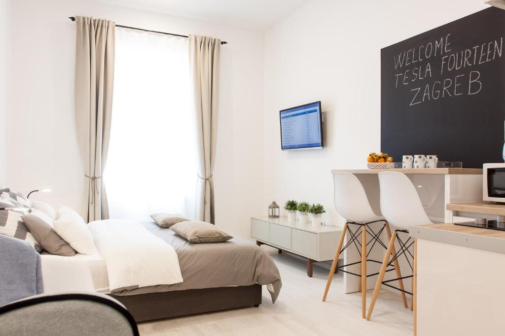 A television and/or entertainment center at Tesla Boutique Apartments & Rooms