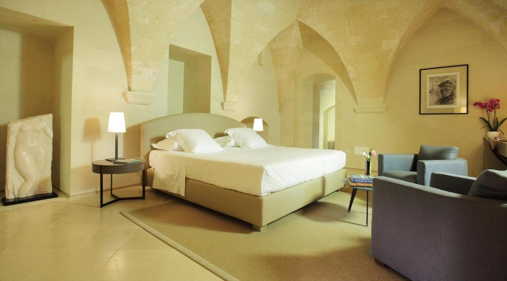 A bed or beds in a room at La Fiermontina - luxury home hotel