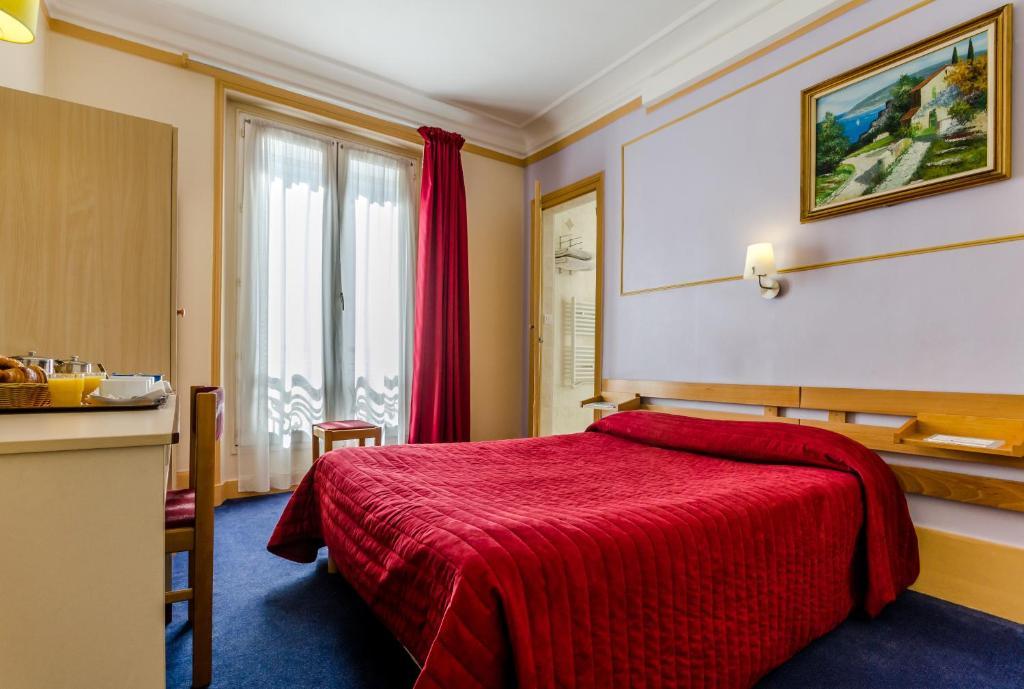 Кровать или кровати в номере Avenir Hotel Montmartre