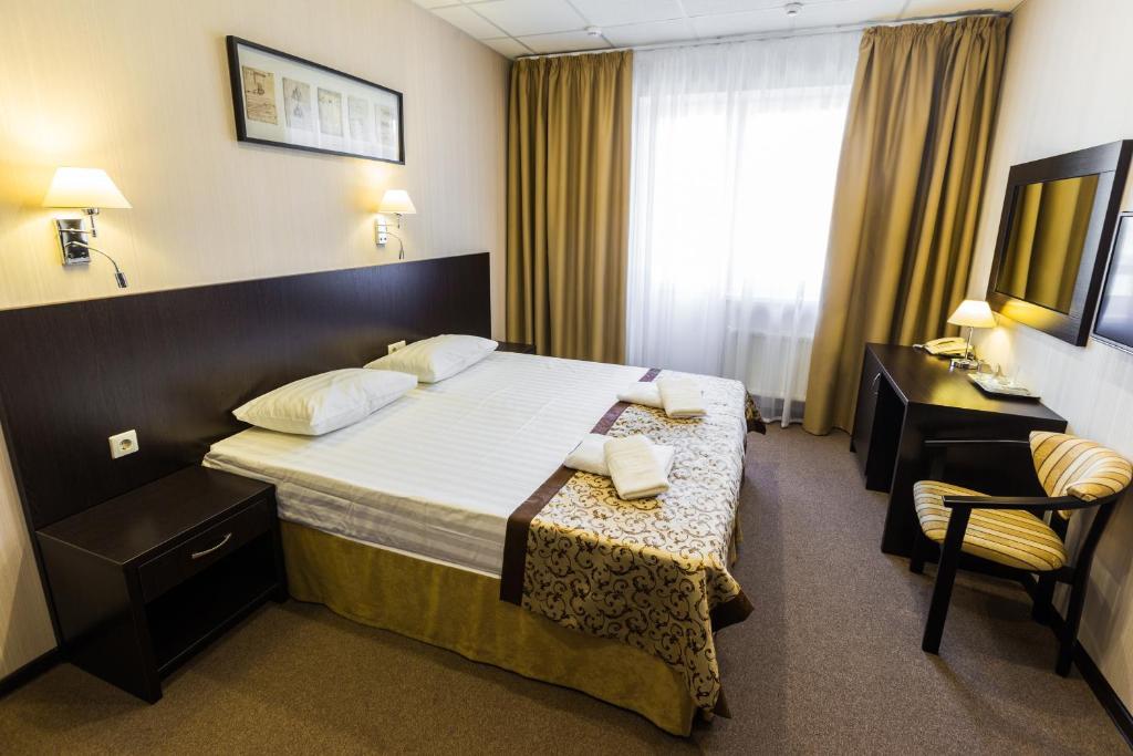 Кровать или кровати в номере В Двух Шагах от Старого Центра