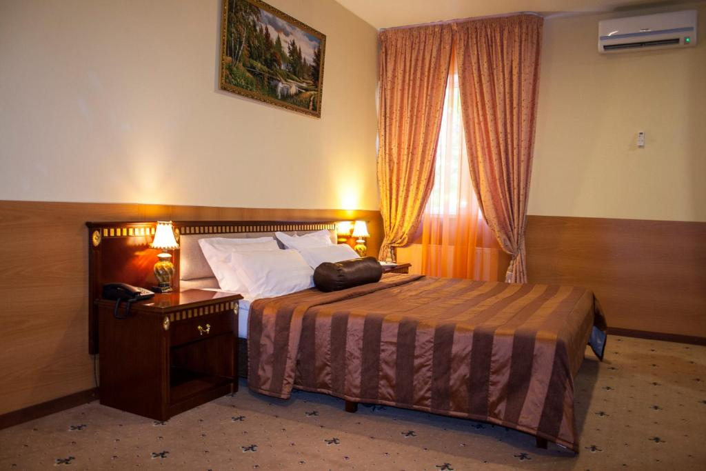 A bed or beds in a room at Sokolniki Hotel