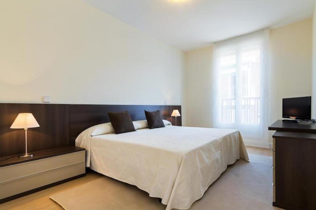 Cama o camas de una habitación en BBC Rooms