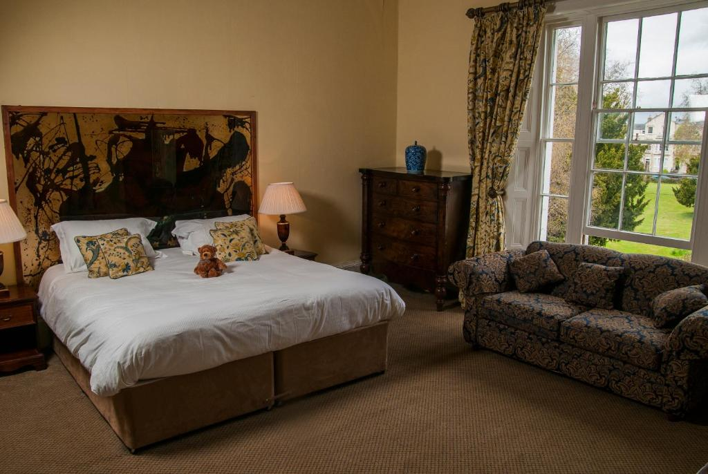 A bed or beds in a room at Clarence Court Hotel