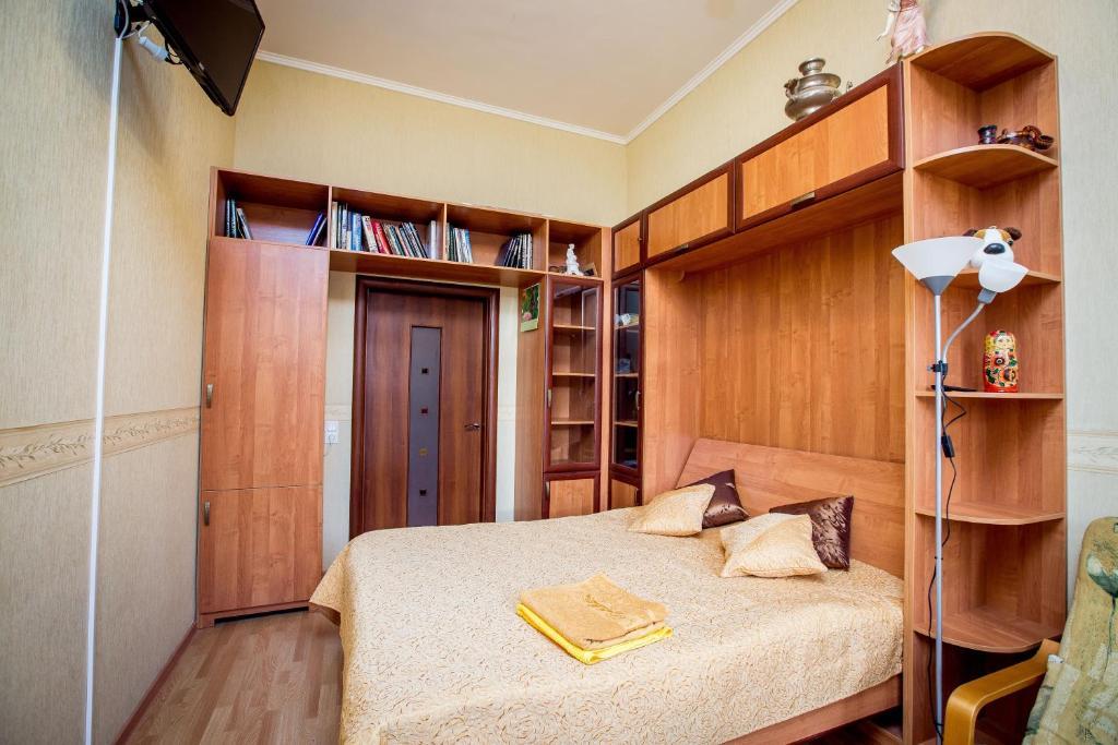 Кровать или кровати в номере Apartment Petrogradsky
