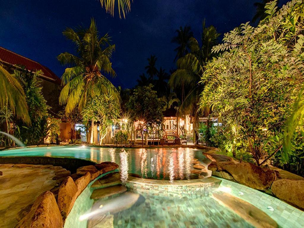 The swimming pool at or near Ganesh Lodge