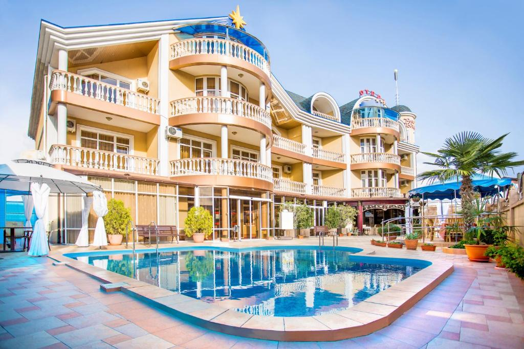 Бассейн в Wind Rose Hotel & SPA или поблизости