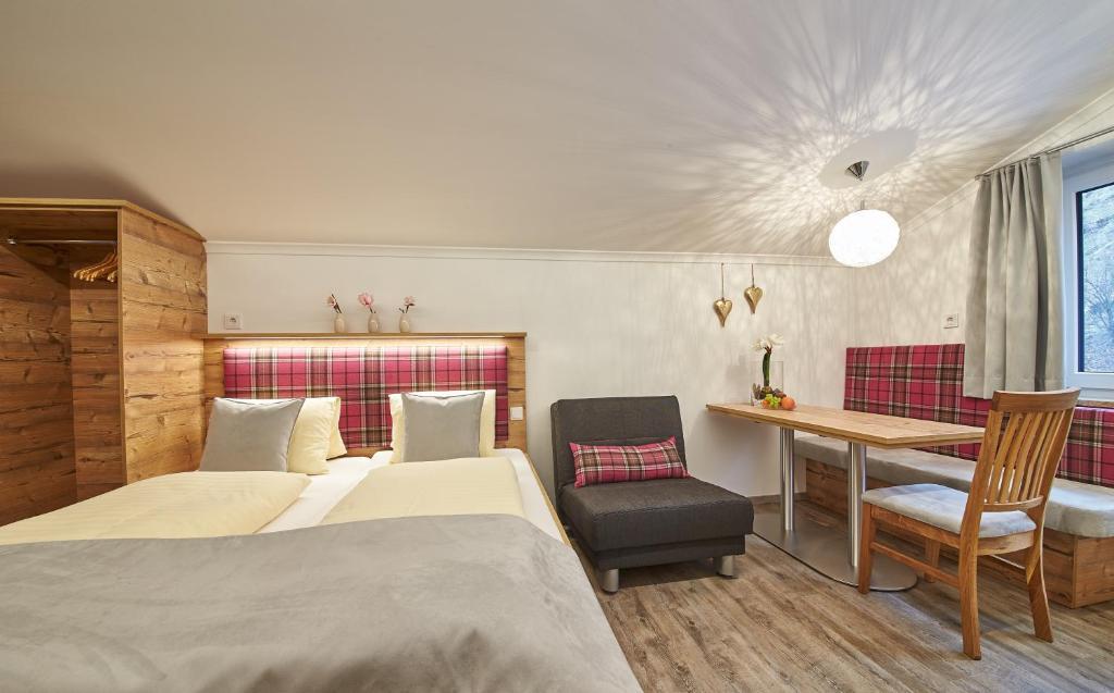 Ein Bett oder Betten in einem Zimmer der Unterkunft Landhaus Keil