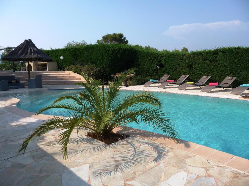 The swimming pool at or near La Bastide Des Selves