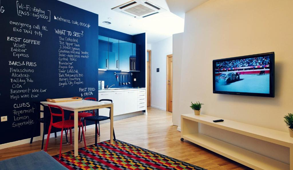 A television and/or entertainment center at Central Downtown Apartments by Irundo