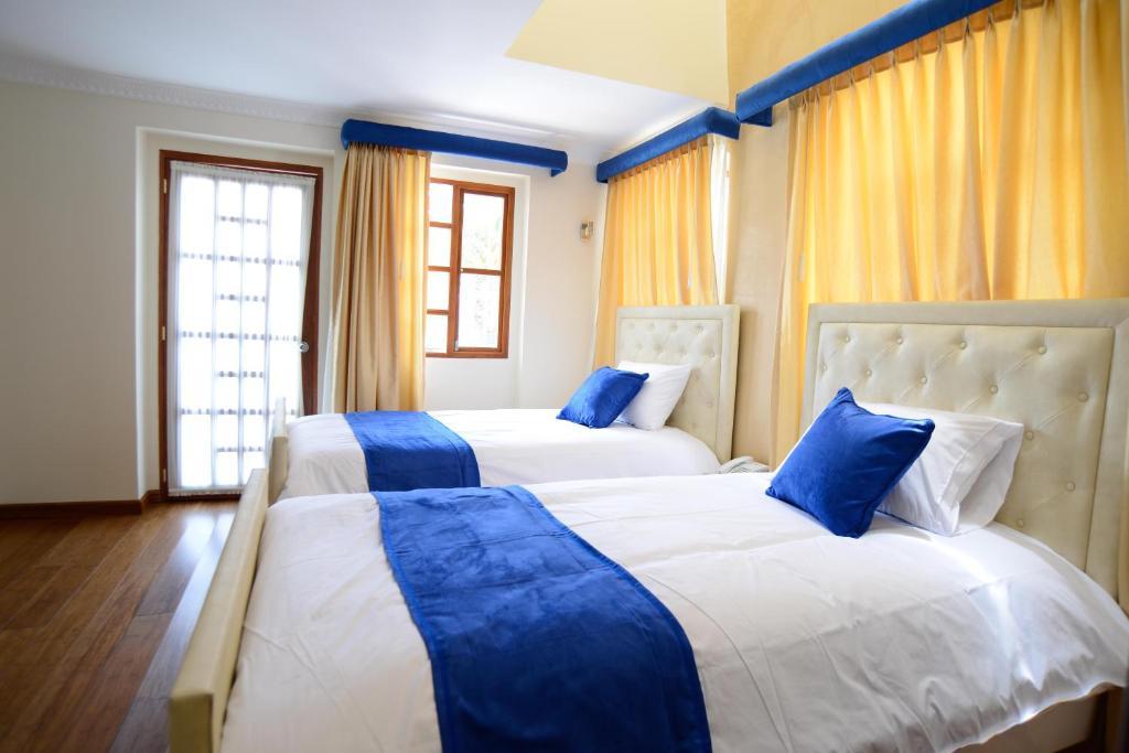 Cama o camas de una habitación en Marquiz Hotel Boutique
