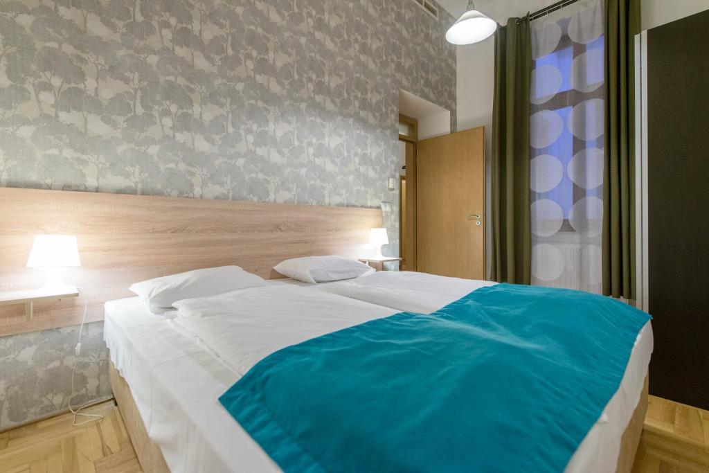מיטה או מיטות בחדר ב-Mango Aparthotel